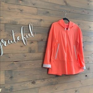 Neon peach Lululemon jacket with hood